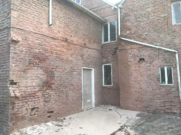 Before and after pictures of paint removal off brickwork using sandblasting in Malpas Cheshire. - Sandblasting Services